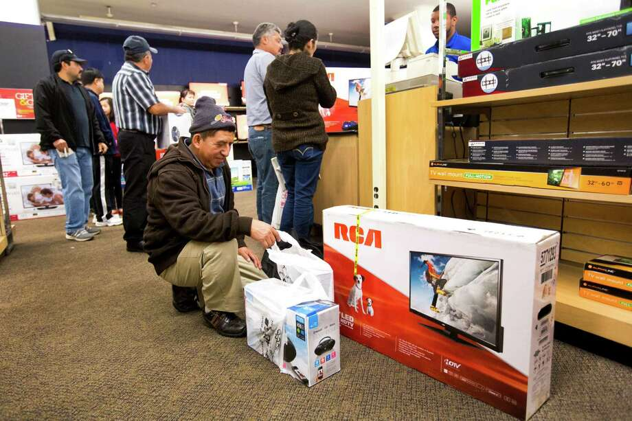 Luis Chanchavac bought an RCA 32-inch television, and other electronics, Friday, Nov. 29, 2013, in Houston. Photo: Marie D. De Jesus, Houston Chronicle / © 2013 Houston Chronicle