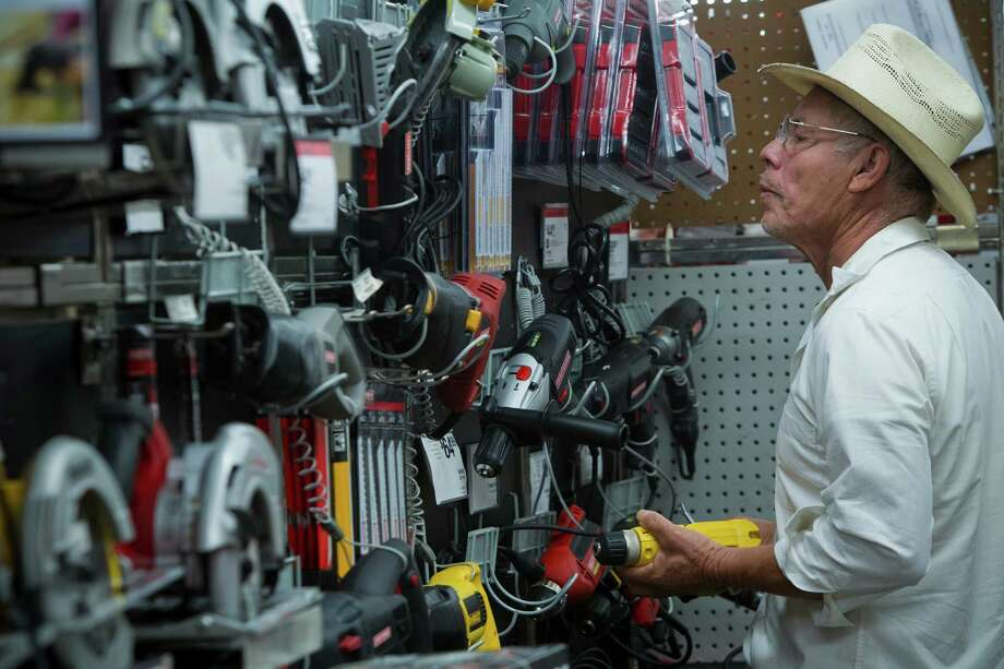 Antonio Aguirre shops for tools which has been one of the most popular items selling at Sears on 4201 Main St. on Black Friday, Friday, Nov. 29, 2013, in Houston. Photo: Marie D. De Jesus, Houston Chronicle / © 2013 Houston Chronicle
