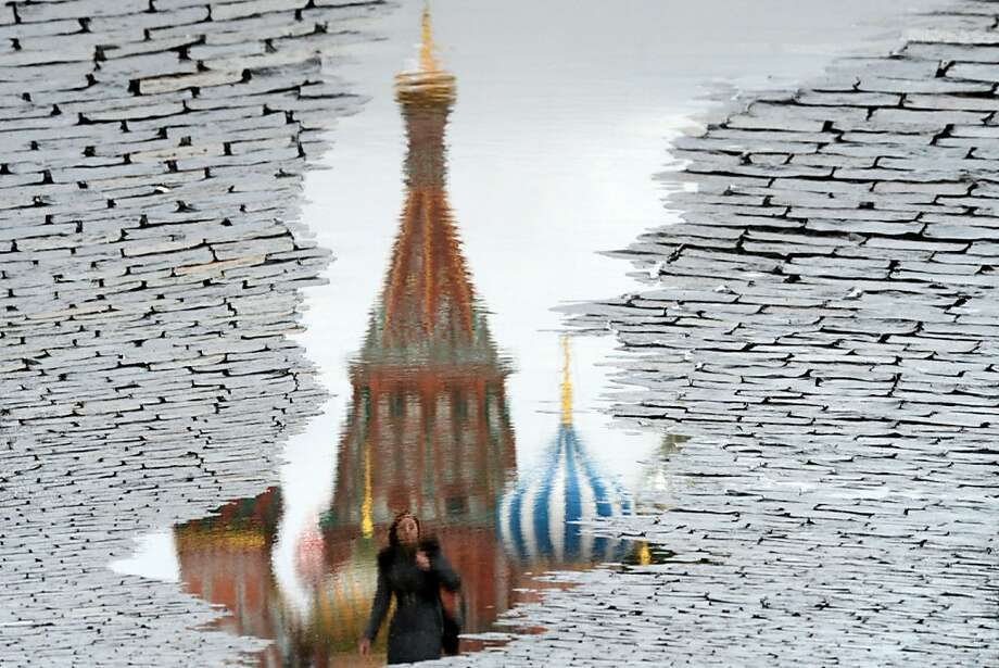 A photo rotated 180 degreesof a puddle in Moscow's Red Square shows the reflection of a woman passing the landmark St. Basil's Cathedral. Photo: Kirill Kudryavtsev, AFP/Getty Images