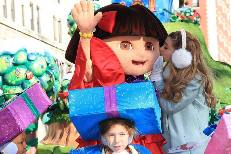 Rocking the float:Singer/actress Ariana Grande kisses Dora the Explorer amid gift-headed munchkins on a Macy's Thanksgiving Day Parade float in New York. Photo: John Barrett/Gobe Photos, McClatchy-Tribune News Service