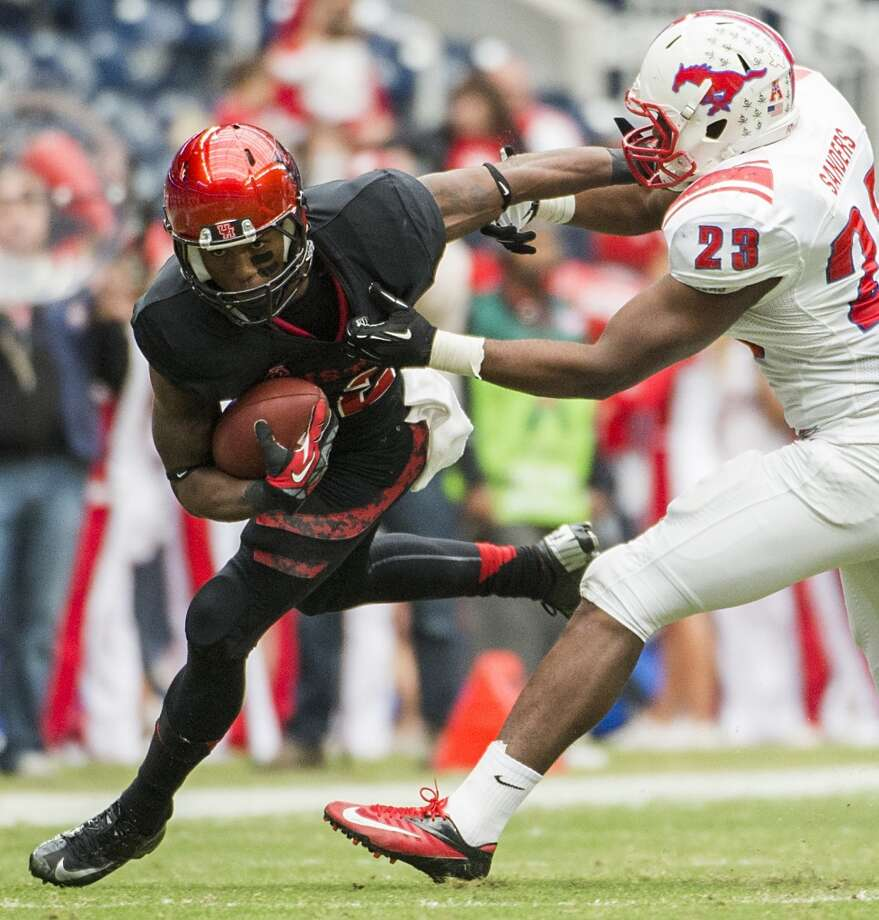 UH running back Ryan Jackson attempts to gain yardage against SMU. Photo: Smiley N. Pool, Houston Chronicle