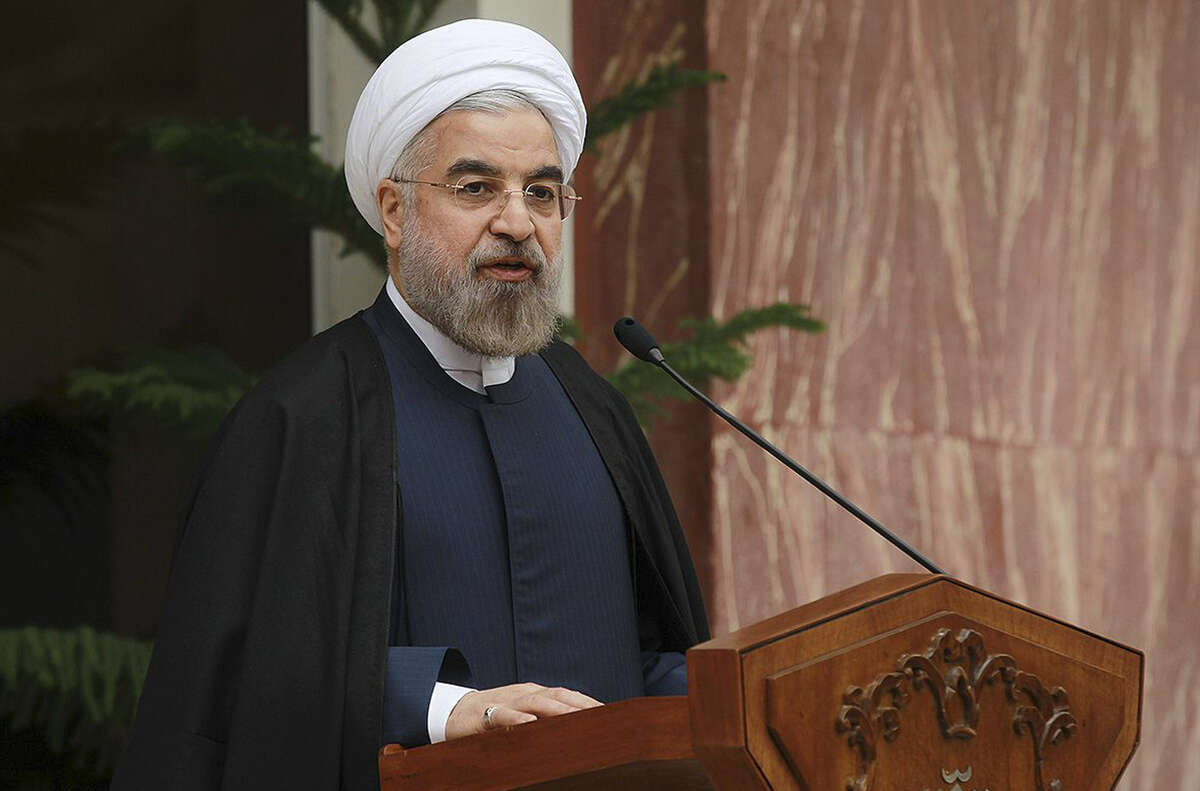 Iran's President Hassan Rouhani speaks during a news briefing after Iran and world powers agree in Geneva to a deal over Iran's nuclear program, from the presidency compound in Tehran, Iran, on Sunday. An Express-News reader criticizes the GOP for its disapproval of the agreement made in Iran.