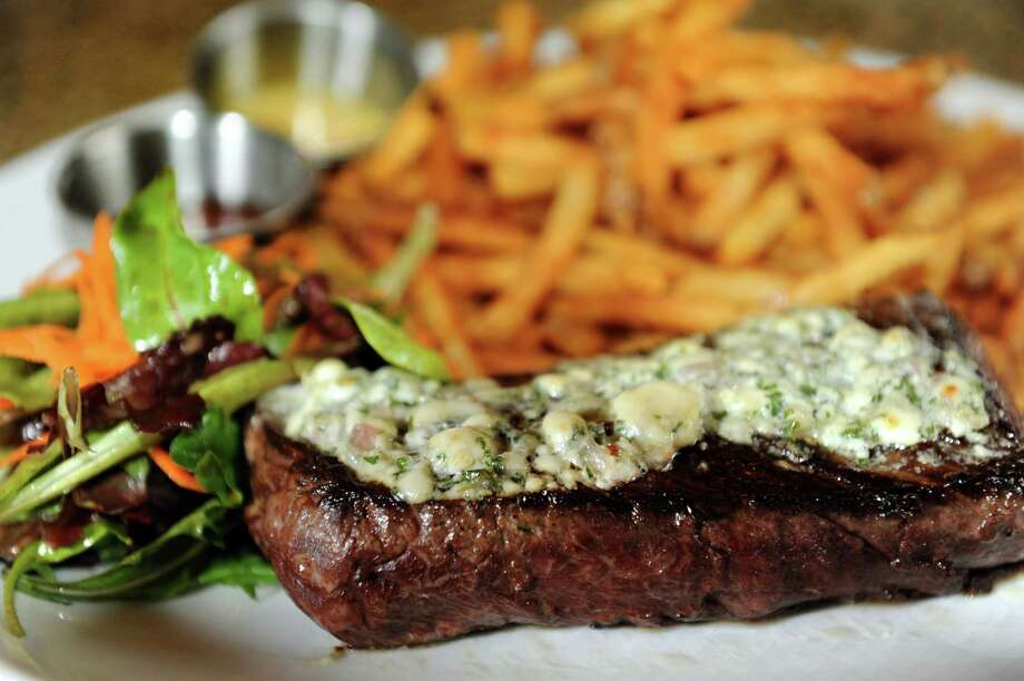 Hanger Steak Frites is a tender-cut steak with blue cheese-shallot butter and served with fries and a salad on Thursday, Nov. 21, 2013, at Garden Bistro 24 in Slingerlands, N.Y. (Cindy Schultz / Times Union) Photo: Cindy Schultz / 00024738A