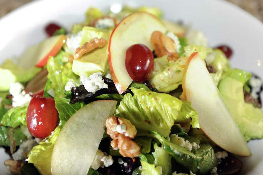 Garden Bistro 24. 5 Vista Blvd., Slingerlands.Merabec Salad has crisp lettuce mix tossed with fresh grapes, dried cherries, toasted walnuts, apples, avocado and crumbled blue cheese with maple-mustard vinaigrette on Thursday, Nov. 21, 2013, at Garden Bistro 24 in Slingerlands, N.Y. (Cindy Schultz / Times Union) Photo: Cindy Schultz / 00024738A