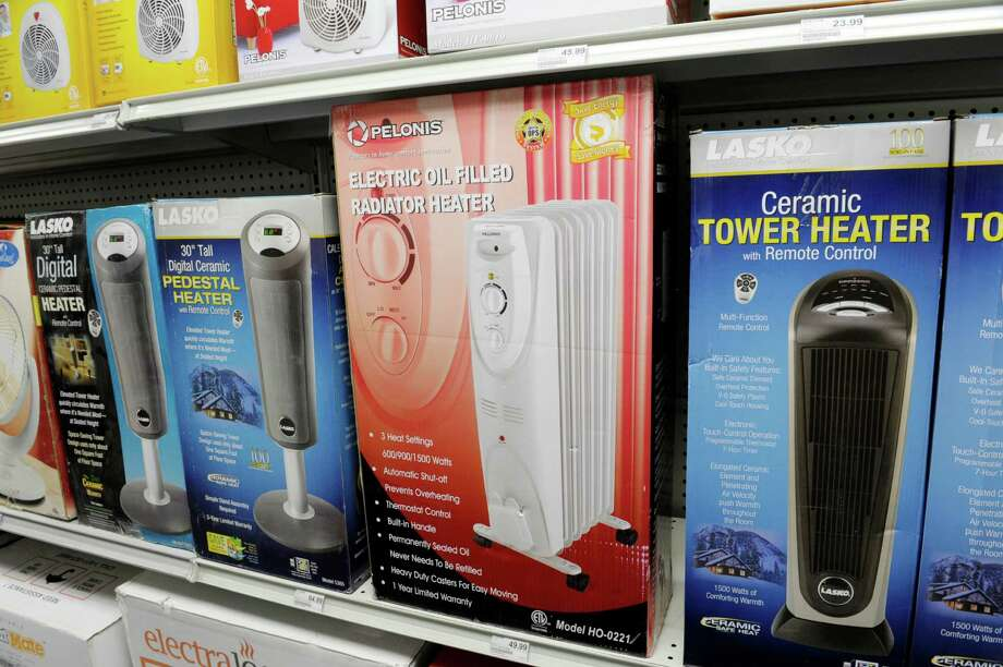 A view of some of the space heaters for homes on the shelf at Robinson Ace Hardware on Monday, Nov. 18, 2013 in Guilderland, NY.   (Paul Buckowski / Times Union) Photo: Paul Buckowski / 00024660A