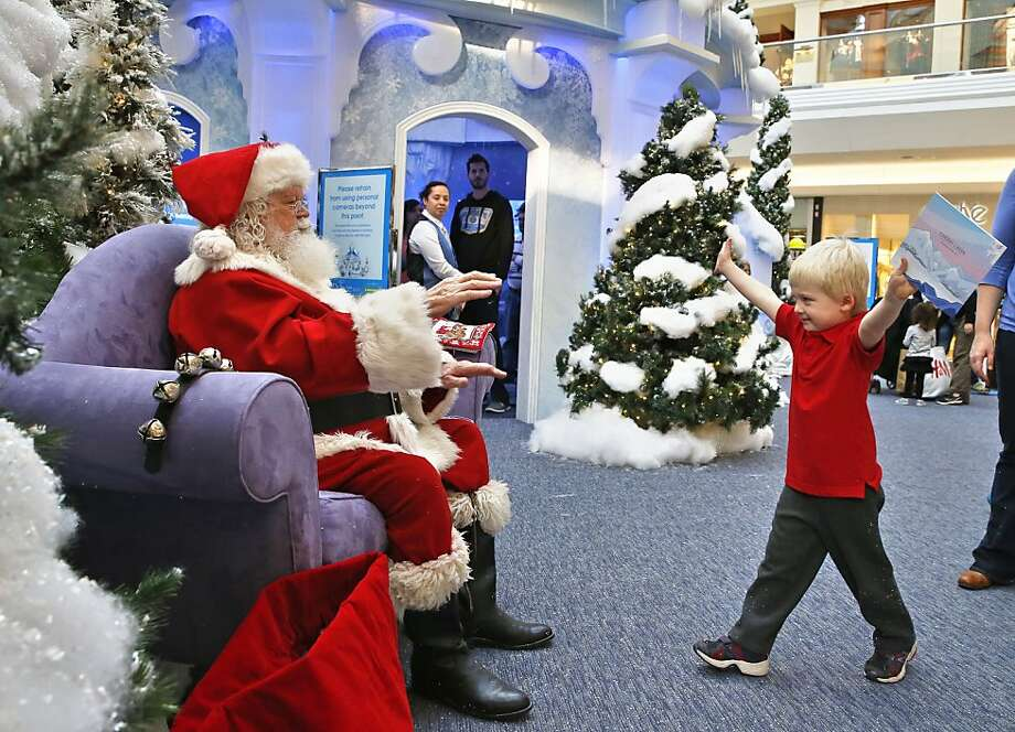 My Christmas list is this big: Four-year-old John Doris greets Santa at Cherry Creek Mall in Denver. Photo: Brennan Linsley, Associated Press