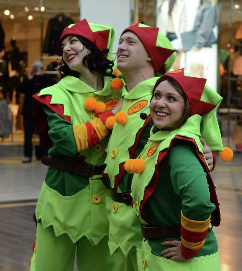Merry Making elves entertain shoppers on Black Friday, Nov. 26, 2013 at Westfield Connecticut Post mall in Milford, Conn. Photo: Autumn Driscoll / Connecticut Post