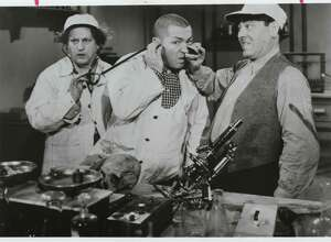 """Larry Fine, Curly Howard and Moe Howard, the original film Three Stooges, exhibit their wild brand of slapstick comedy in the 1946 film """"A Bird in the Head."""" Beginning in 1934, the Three Stooges made 190 """"shorts"""" (movies less than 20 minutes in length) during their 25-year tenure with Columbia Pictures. Mylstar Electronics, Inc. has captured their zany comedy in the company's new Three Stooges video arcade game. (Photo courtesy of Columbia Pictures Industries, Inc.).  HOUCHRON CAPTION (05/27/2005) SECSTAR:  LOVE PAT?: The Three Stooges - from left, Larry Fine, Curly Howard and Moe Howard - were no strangers to slaps.  HOUCHRON CAPTION (07/20/2005) SECSTAR:  NYUK NYUK NYUK: The Three Stooges set the standard for dopey janitors in their 1940s shorts."""