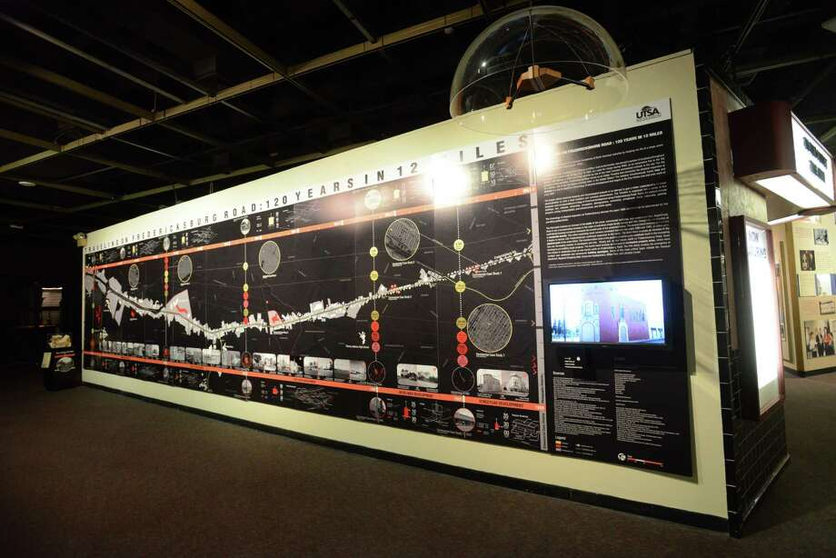 An exhibit at the Institute of Texas Cultures about the history of Fredericksburg Road and how it relates to development is on display on Nov. 29, 2013. Photo: Billy Calzada, San Antonio Express-News / San Antonio Express-News