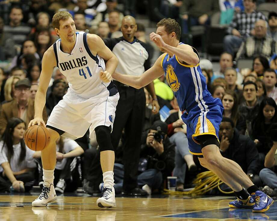 Dirk Nowitzki and the Mavericks let David Lee and the Warriors know that no ascendancy is simply preordained. The Western Conference is as deep as ever. Photo: Matt Strasen, Associated Press