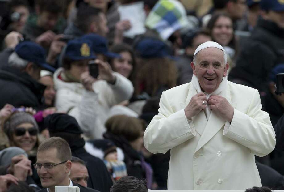 "Among other things, Pope Francis' ""Evangelii Gaudium"" (""The Joy of the Gospel"") calls on the church to resist forces of consumerism, capitalism and greed that define U.S. life. Photo: Alessandra Tarantino / Associated Press"