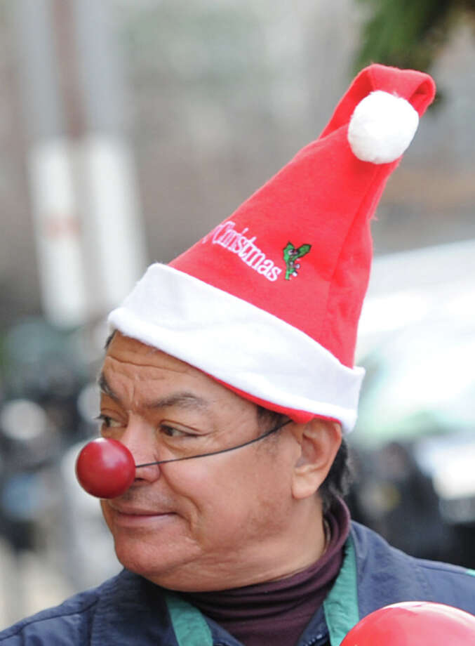Freddy Cantante of Greenwich wore a red nose and Santa hat before the start of the Greenwich Reindeer Parade on Greenwich Avenue, Friday afternoon, Nov. 29, 2013. Santa and four reindeer can be seen at McArdle's at 48 Arch Street in Greenwich up until Dec. 23, for more information visit: https://mcardles.com/blog/228/ Photo: Bob Luckey / Greenwich Time