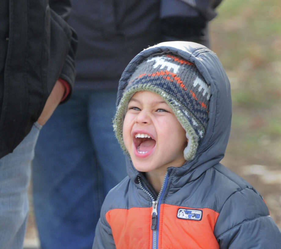 Nicholas Domenici, 3, of Trumbull, Conn., shouts for Santa before the start of the Greenwich Reindeer Parade on Greenwich Avenue, Friday afternoon, Nov. 29, 2013. Santa and four reindeer can be seen at McArdle's at 48 Arch Street in Greenwich up until Dec. 23, for more information visit: https://mcardles.com/blog/228/ Photo: Bob Luckey / Greenwich Time