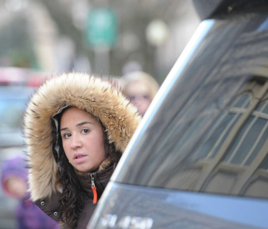 Danielle Flaccavento of Brookfield, Conn., was on the lookout for Santa before the start of the Greenwich Reindeer Parade on Greenwich Avenue, Friday afternoon, Nov. 29, 2013. Santa and four reindeer can be seen at McArdle's at 48 Arch Street in Greenwich up until Dec. 23, for more information visit: https://mcardles.com/blog/228/ Photo: Bob Luckey / Greenwich Time