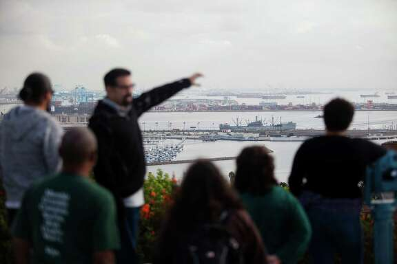 A Houston-area group during a visit last week hears Angelo Logan discuss the environmental impact of the Los Angeles port.