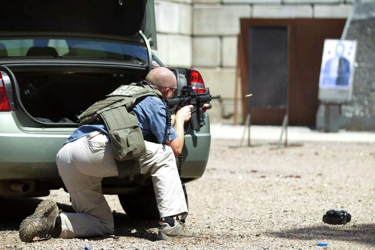 An agent for the Bureau of Alcohol, Tobacco, Firearms and Explosives undergoes a training exercise at the Montgomery County firearms range in June.