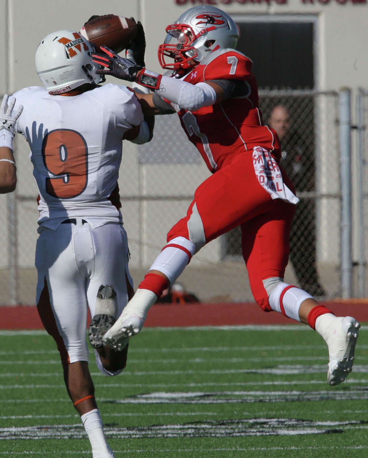 Madison's Devon Thomas snags a pass as Mission Sharyland's Sean Landez defends on the play in the fourth quarter play during a regional playoffs game at Buccaneer Stadium in Corpus Christi on Friday, Nov. 29, 2013.