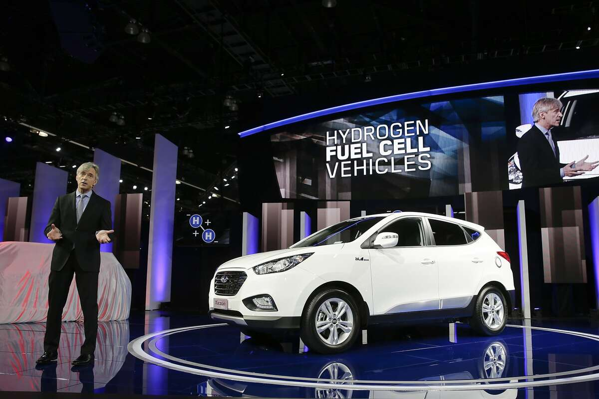 John Krafcik, president and CEO of Hyundai Motor America, introduces the Tucson Fuel Cell hydrogen-powered electric vehicle at the Los Angeles Auto Show on Wednesday, Nov. 20, 2013, in Los Angeles.