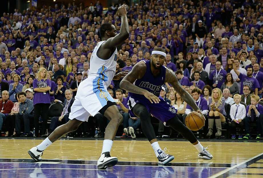 Sacramento's star DeMarcus Cousins drives to the basket against Denver at the Kings' longtime home, Sleep Train Arena. Photo: Thearon W. Henderson, Getty Images