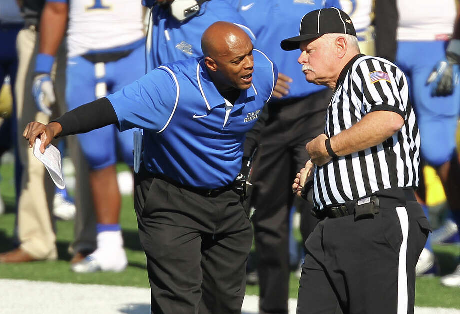 Elkins' head coach Dennis Brantley, left, argues with an official during the first half of a high school football playoff game, Friday, November 29, 2013, at Tully Stadium in Houston. Photo: Eric Christian Smith, For The Chronicle