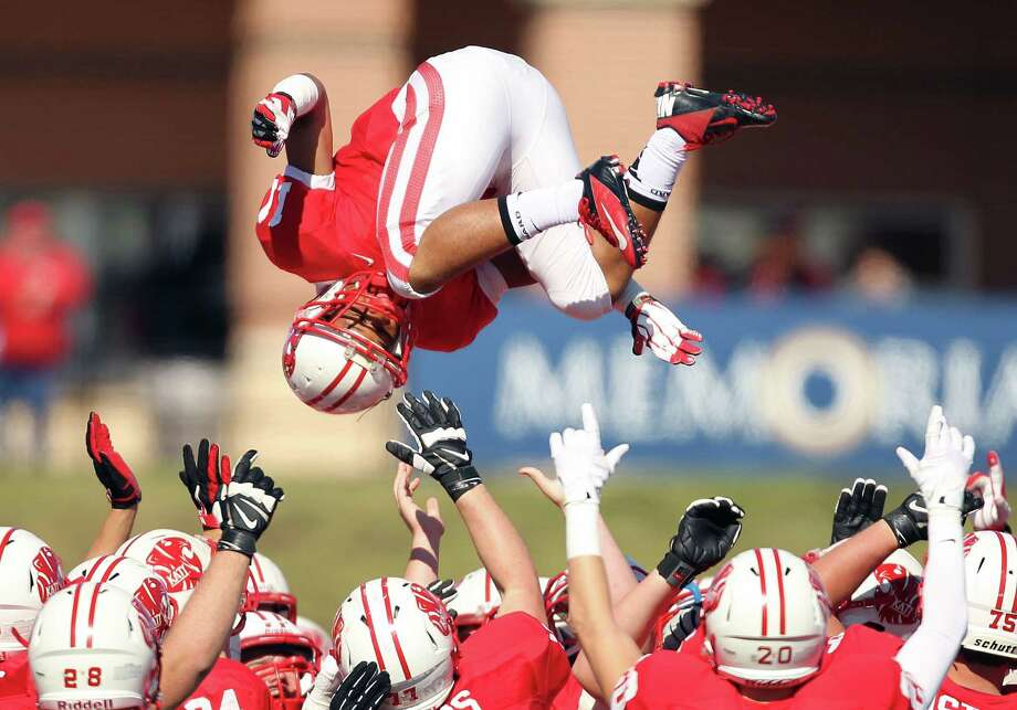 Katy's Christian Fenter is tossed in the air by teammates before a high school football playoff game against Elkins, Friday, November 29, 2013, at Tully Stadium in Houston. Photo: Eric Christian Smith, For The Chronicle