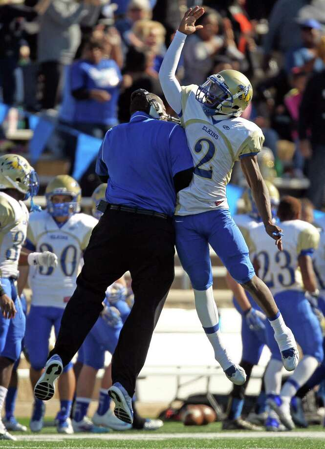 Elkins' Johnathan Giles, (2) celebrated his 23-yard touchdown rush with head coach Dennis Brantley during the first half of a high school football playoff game against Katy, Friday, November 29, 2013, at Tully Stadium in Houston. Photo: Eric Christian Smith, For The Chronicle