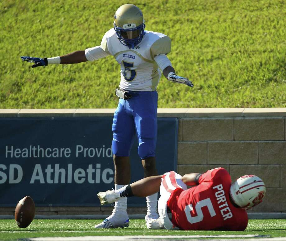 Elkins' Andrew Aneke, left, motions incomplete after breaking up a pass intended for Katy's Kyle Porter during the first half of a high school football playoff game, Friday, November 29, 2013, at Tully Stadium in Houston. Photo: Eric Christian Smith, For The Chronicle