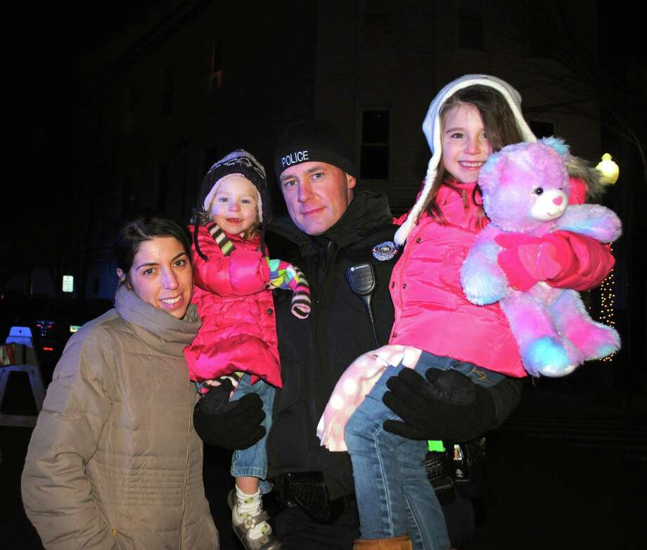 Were you SEEN at the Bethel Chamber of Comerce's Annual Tree Lighting? Friday, November, 29, 2013. Bethel Police Officer Colin Delaney and family. Photo: Wendy Mitchell
