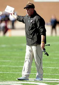 Pearland head coach Tony Heath argues a call during the first half of a High School football game against Houston Lamar at Mercer Stadium on Friday, Nov. 29, 2013, in Sugar Land. Photo: J. Patric Schneider, For The Chronicle / © 2013 Houston Chronicle