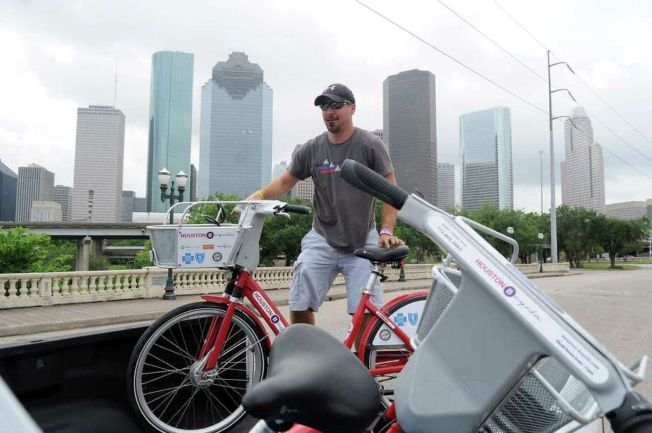 John Vondra, bike tech for the B-Cycle program, stands at the Sabine Street  bridge B-Cyle station, one of 27 in the city. Photo: Dave Rossman, Freelance / © 2013 Dave Rossman