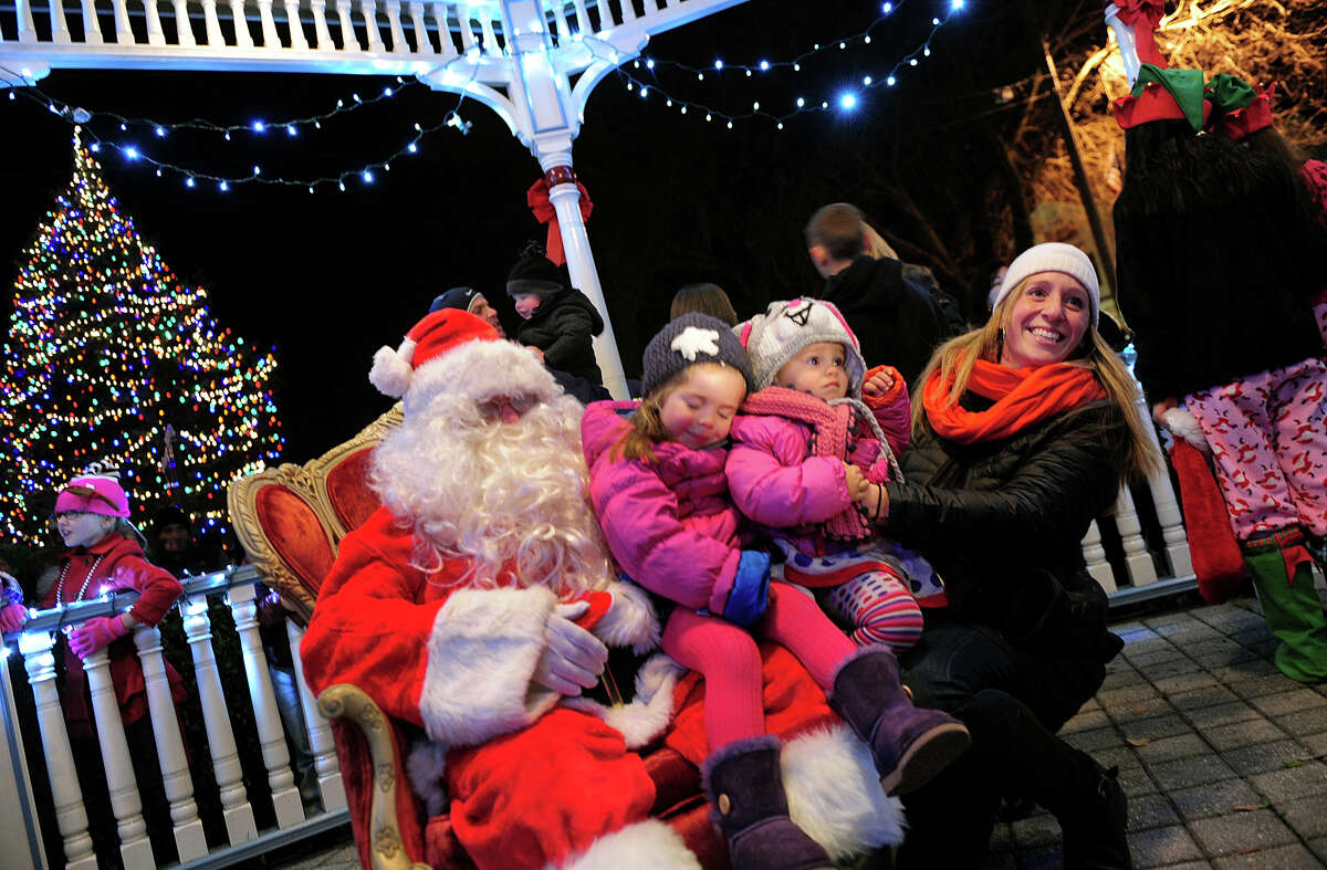 Calliope and Thalia Barry, 3, and 1, of Milford, visit Santa Claus with their mom Marin, during the annual Festival of Lights and Tree Lighting on the historic Milford Green in Milford, Conn. on Friday November 29, 2013.
