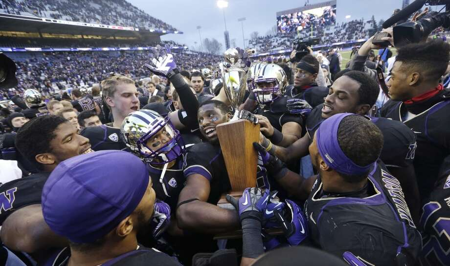 Apple Cup: How Huskies surged back to beat CougarsThe Washington Huskies trailed the Washington State Cougars 10-3 at halftime of Friday's Apple Cup game. But the Dawgs surged back after halftime to steal all the momentum at Husky Stadium and beat the Cougs 27-17 in another wild rivalry matchup. How did the Huskies do it? Here's a look at what the UW did to fight back, achieve its eighth win of the season and reclaim statewide football superiority for the next 364 days. Photo: Elaine Thompson, Associated Press