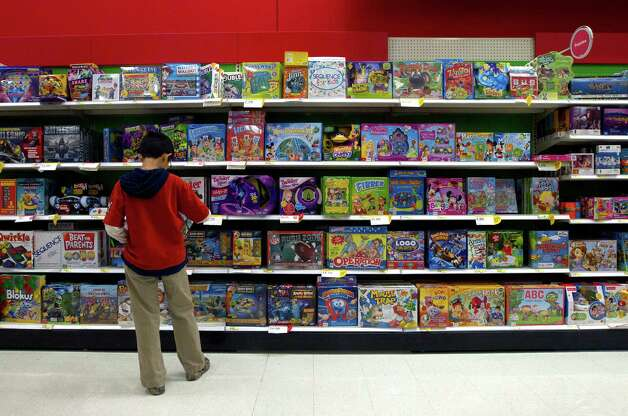 Patrick Han, 12, looks at games during Black Friday, at Target, Nov. 29, 2013, in Houston. (Cody Duty / Houston Chronicle) Photo: Cody Duty, Staff / © 2013 Houston Chronicle