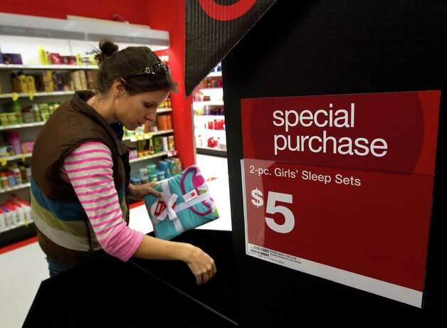 Jenny Dye shops during Black Friday at Target, Nov. 29, 2013, in Houston. Dye said she was just looking for sales. (Cody Duty / Houston Chronicle) Photo: Cody Duty, Staff / © 2013 Houston Chronicle