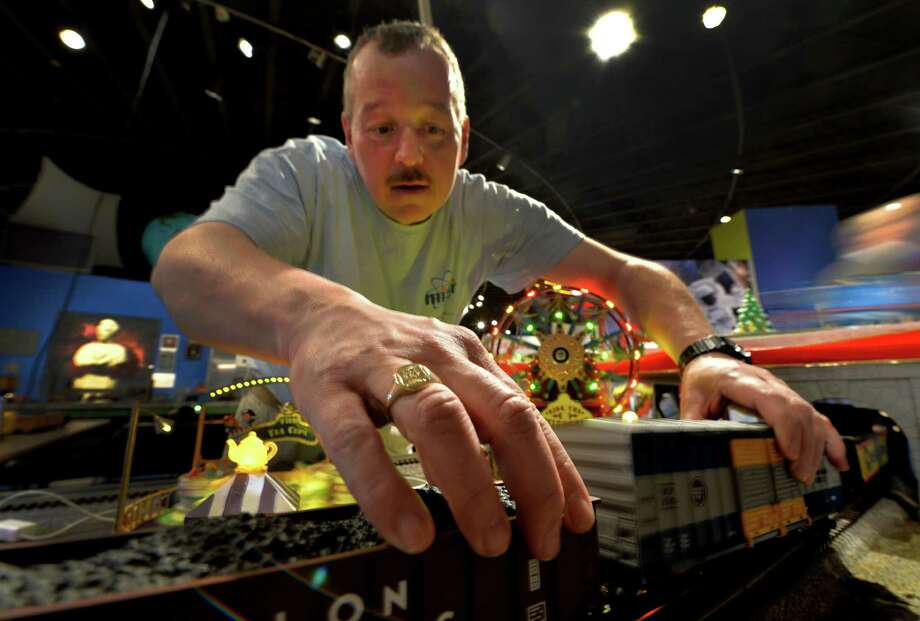 Dan Brown, educator,  works on a derailment during the opening of the annual Model Train exhibit at the miSci Nov. 29, 2013 in Schenectady, N.Y.    (Skip Dickstein/Times Union) Photo: SKIP DICKSTEIN / 00024830A