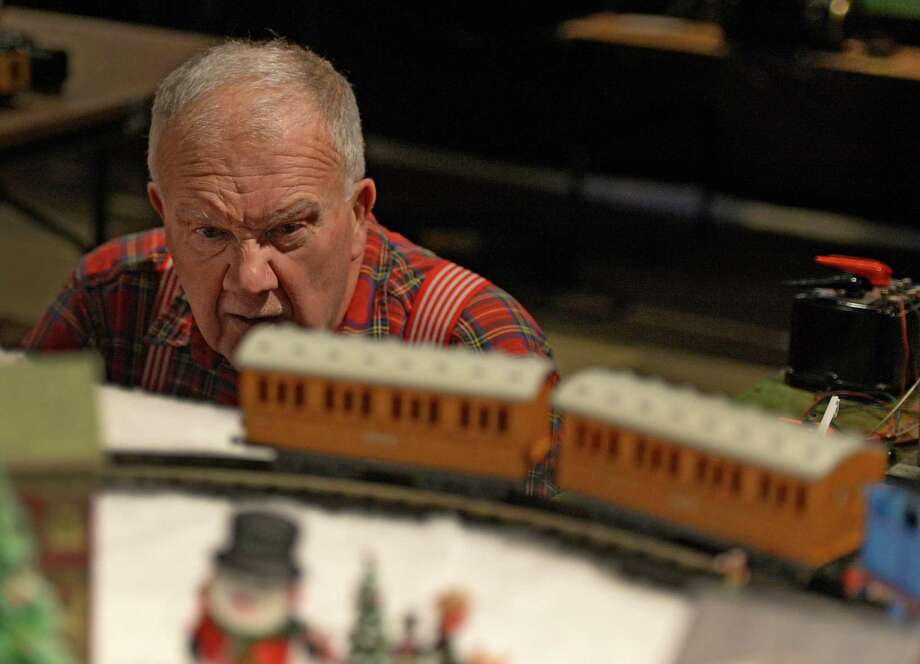 Model train master Dave Acker tries to diagnose a derailment during the opening day of the annual Model Train exhibit at the miSci Nov. 29, 2013 in Schenectady, N.Y.    (Skip Dickstein/Times Union) Photo: SKIP DICKSTEIN / 00024830A