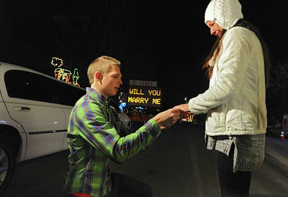 Mason Moriarty asks Taylor Waters to marry him while going through the Holiday Lights in the Park in a limo at Washington Park on Friday, Nov. 29, 2013 in Albany, N.Y. The couple who are high school sweethearts are from Painfield, Conn. and were visiting family for Thanksgiving. (Lori Van Buren / Times Union) Photo: Lori Van Buren / 00024844A