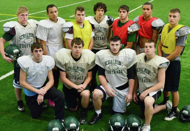 Starting defense of the Schalmont football team, from top left, Dominic Friello, Trevon Perez-Tucker, Jack Batchler, Paul Mattick, Nick Gallo, Devon Willis and Kyle Strube, first row from left, Hunter Gac, Evan Della Villa, Marcus Ramundo and Kevin Paskevich at practice Friday at the Halmoon Sportsplex in Halfmoon, NY.   (John Carl D'Annibale / Times Union) Photo: John Carl D'Annibale / 00024838A