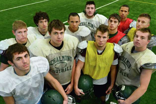 Starting defense of the Schalmont football team, from left, Hunter Gac, Dominic Friello, Paul Mattick, Evan Della Villa,   Trevon Perez-Tucker, Marcus Ramundo, Jack Batchler, Nick Gallo, Devon Willis, Kyle Strube and Kevin Paskevich at practice Friday at the Halmoon Sportsplex in Halfmoon, NY.   (John Carl D'Annibale / Times Union) Photo: John Carl D'Annibale / 00024838A