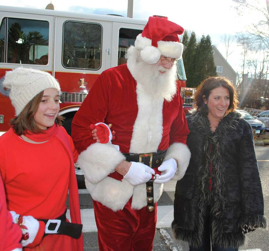 Were you SEEN at Bethel Chamber of Commerce Annual Winter Fest? Friday, November 29, 2013. Bethel Chamber Executive Director Bobbi Jo Beers and Christiana Ruiz escort Santa to waiting children. Photo: Wendy Mtichell