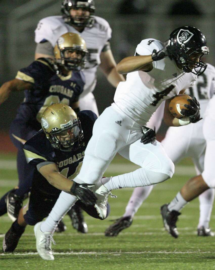 Steele's Justin Stockton tries to break free from Edinburg North Joel Guerrero during first quarter play at Cabiniss Field in Corpus Christi on Friday, Nov. 29, 2013.