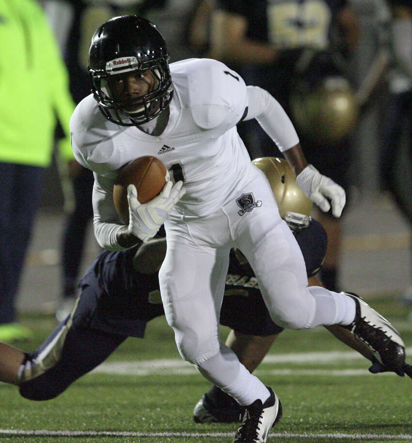 Steele's Jaylen Harris on a pass and catch looks up field for yardage against Edinburg North during first quarter play at Cabiniss Field in Corpus Christi on Friday, Nov. 29, 2013.