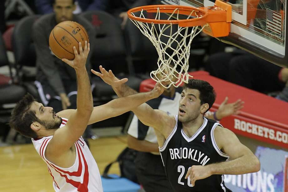 Nov. 29: Rockets 114, Nets 95   Rockets small forward Omri Casspi left, shoots the ball over Nets small forward Tornike Shengelia. Photo: James Nielsen, Houston Chronicle