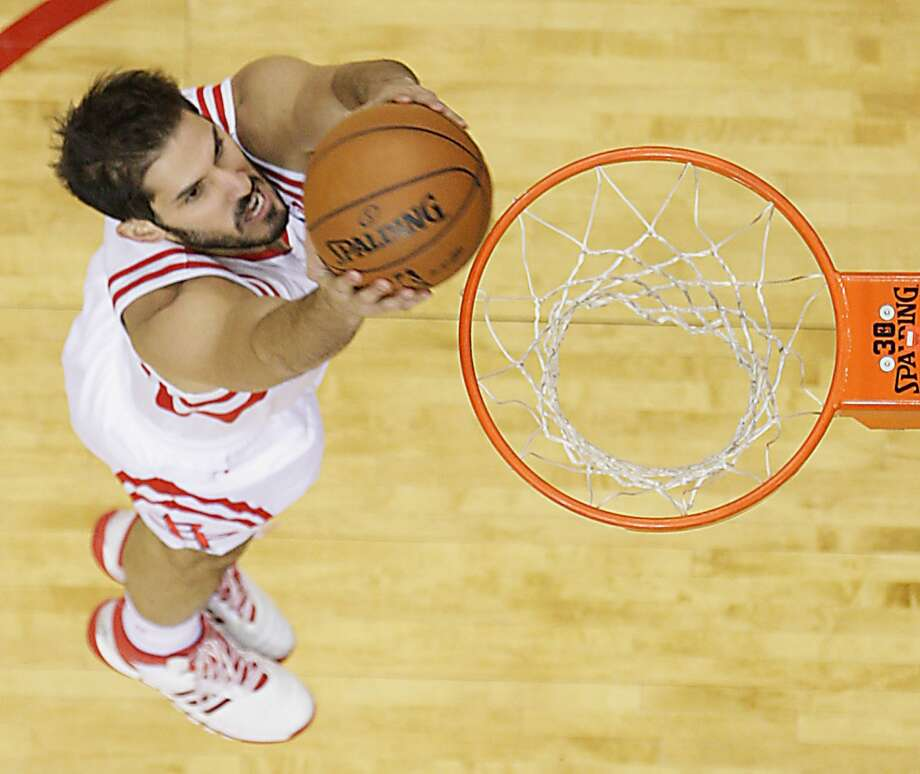 Rockets small forward Omri Casspi dunks the ball. Photo: James Nielsen, Houston Chronicle