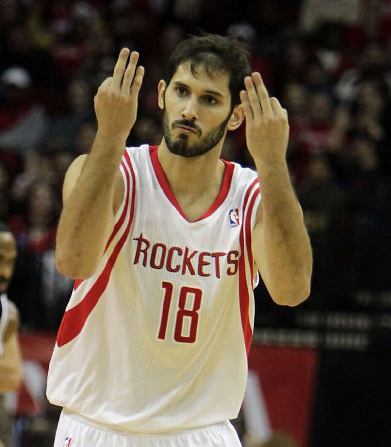 Rockets small forward Omri Casspi reacts after making a three pointer. Photo: James Nielsen, Houston Chronicle