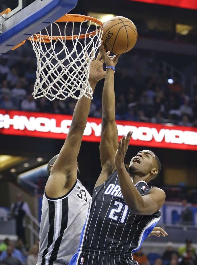 Orlando Magic's Maurice Harkless (21) makes a shot over San Antonio Spurs' Boris Diaw (33), of France, during the first half of an NBA basketball game in Orlando, Fla., Friday, Nov. 29, 2013. (AP Photo/John Raoux) Photo: Associated Press