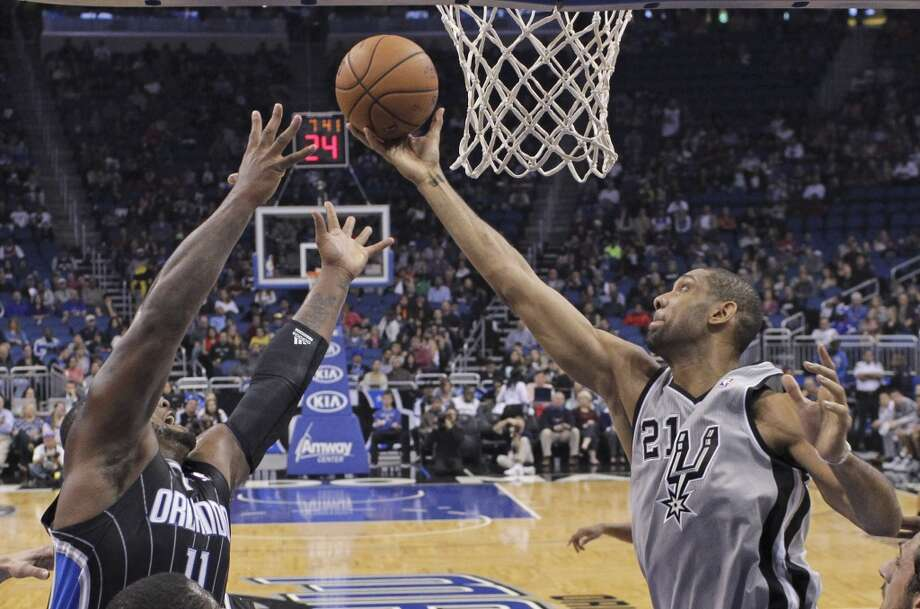 San Antonio Spurs' Tim Duncan (21) goes up for a shot as Orlando Magic's Glen Davis (11) tries to defend during the first half of an NBA basketball game in Orlando, Fla., Friday, Nov. 29, 2013.(AP Photo/John Raoux) Photo: Associated Press