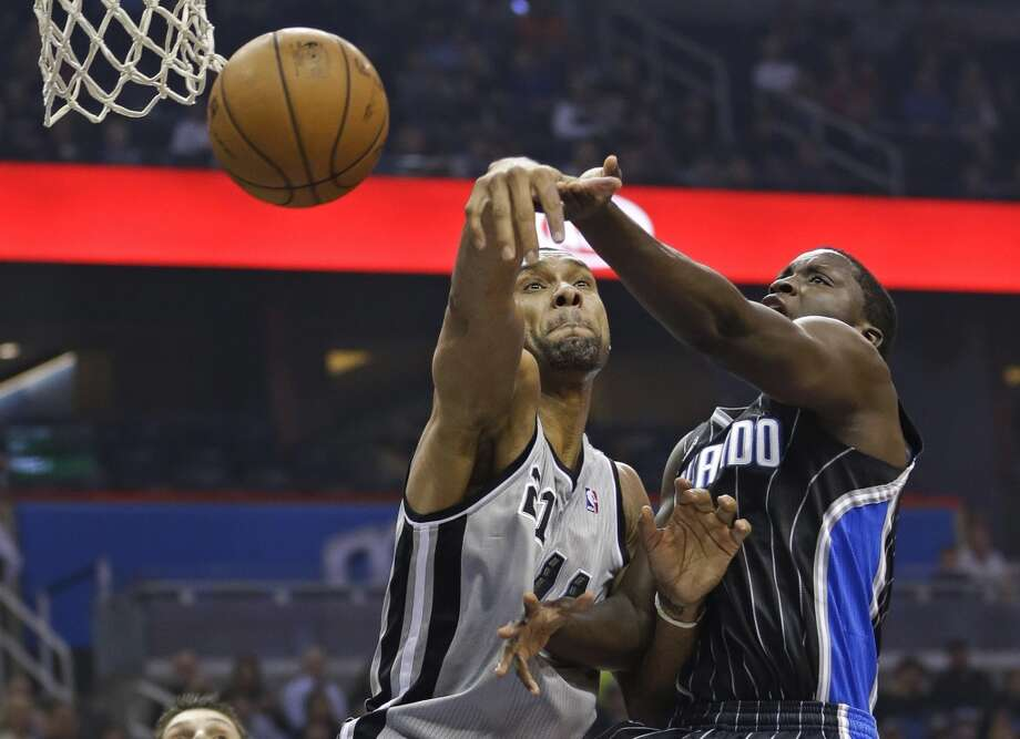 San Antonio Spurs' Tim Duncan, left, blocks a shot by Orlando Magic's Victor Oladipo during the first half of an NBA basketball game in Orlando, Fla., Friday, Nov. 29, 2013.(AP Photo/John Raoux) Photo: Associated Press