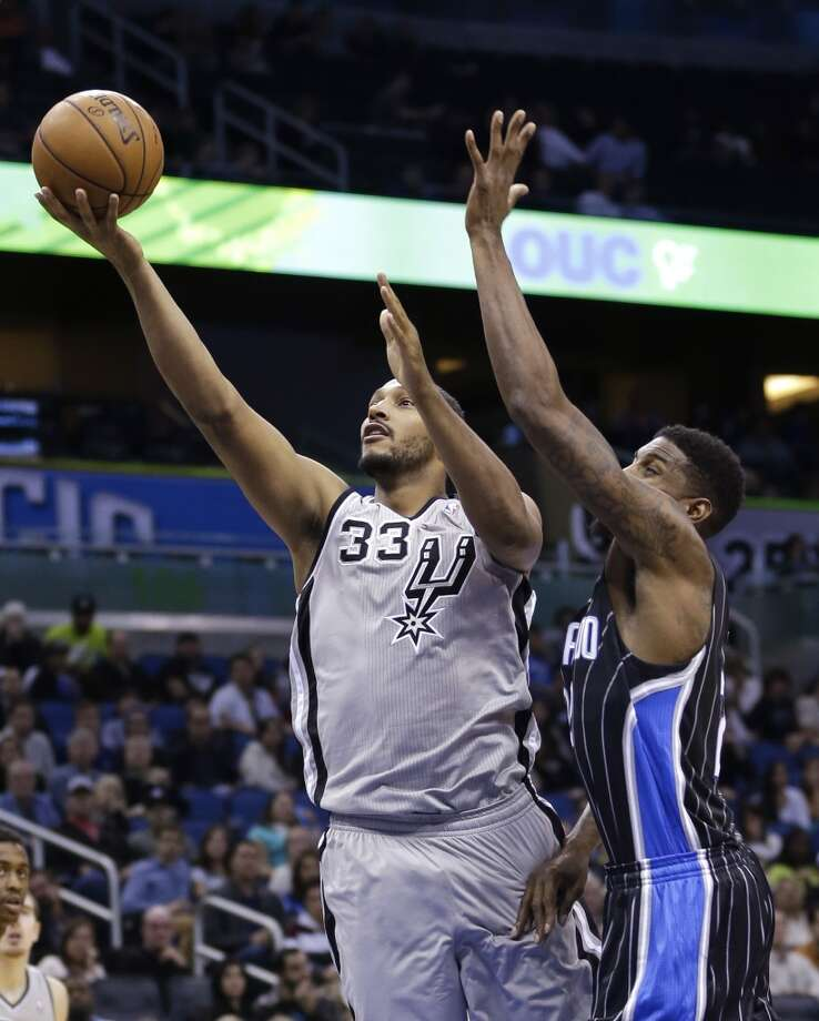 San Antonio Spurs' Boris Diaw (33), of France, gets out in front of Orlando Magic's Maurice Harkless for a shot during the second half of an NBA basketball game in Orlando, Fla., Friday, Nov. 29, 2013. The Spurs won 109-91. (AP Photo/John Raoux) Photo: Associated Press