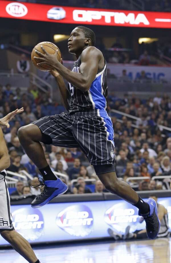 Orlando Magic's Victor Oladipo (5) takes a shot against the San Antonio Spurs during the first half of an NBA basketball game in Orlando, Fla., Friday, Nov. 29, 2013.(AP Photo/John Raoux) Photo: Associated Press